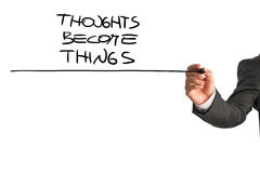 thoughts-become-things-closeup-consultant-underlining-proverb-behind-white-virtual-screen-explaining-how-powerful-57082876